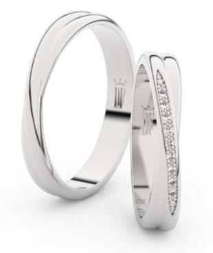 Elegantní snubní prsteny z bílého zlata osazené krásnými zirkony