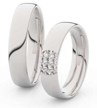 Luxusní široké snubní prsteny z bílého zlata s diamantem